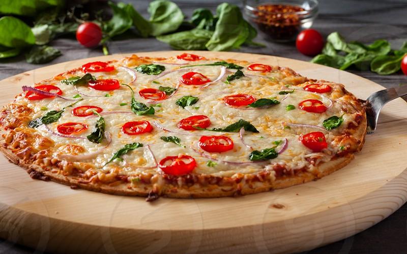 Fresh homemade veggie pizza photo