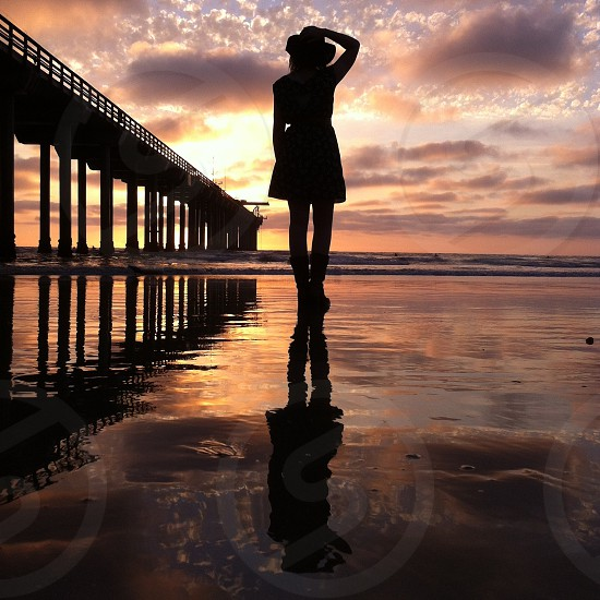 woman silhouette walking on water photography  photo