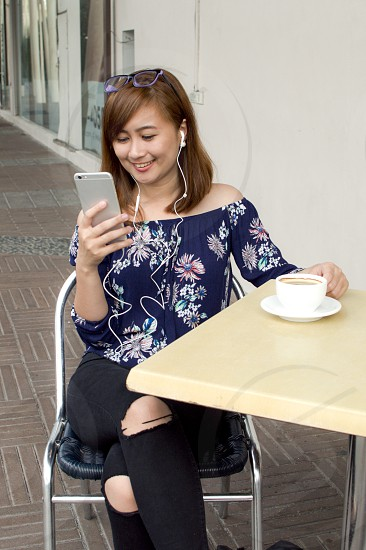 Woman watching video with smartphone photo