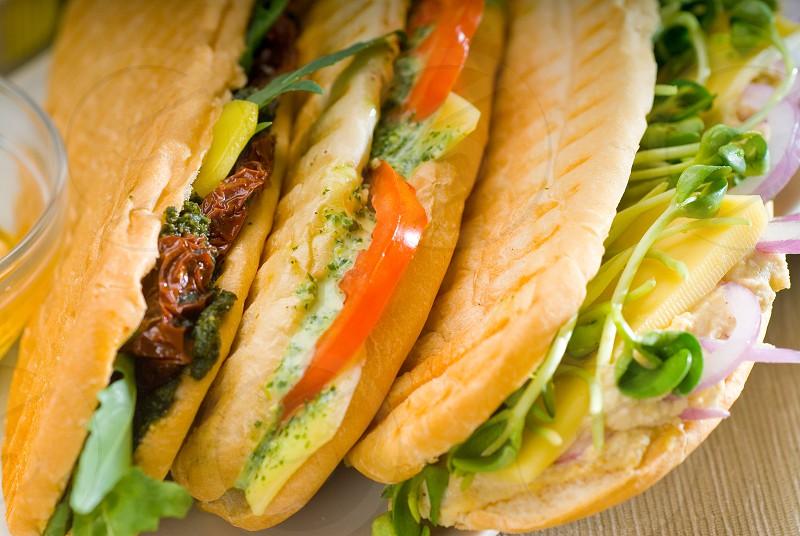 assortment of fresh homemade vegetarian  italian panini sandwichtypical italian snack photo