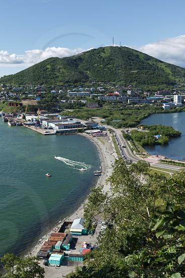 Beautiful summer city landscape: view of port Petropavlovsk-Kamchatsky Avacha Bay and Mishennaya Mountain. Far East Russia Kamchatka Peninsula. photo