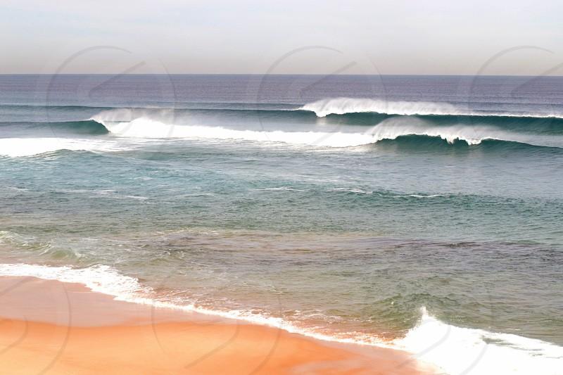 sea waves crashing on the beach photo