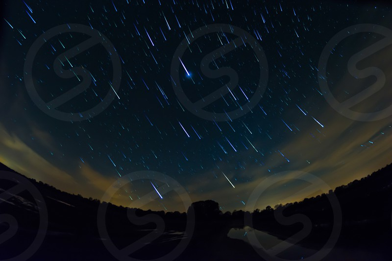meteorites falling from the sky during night photo