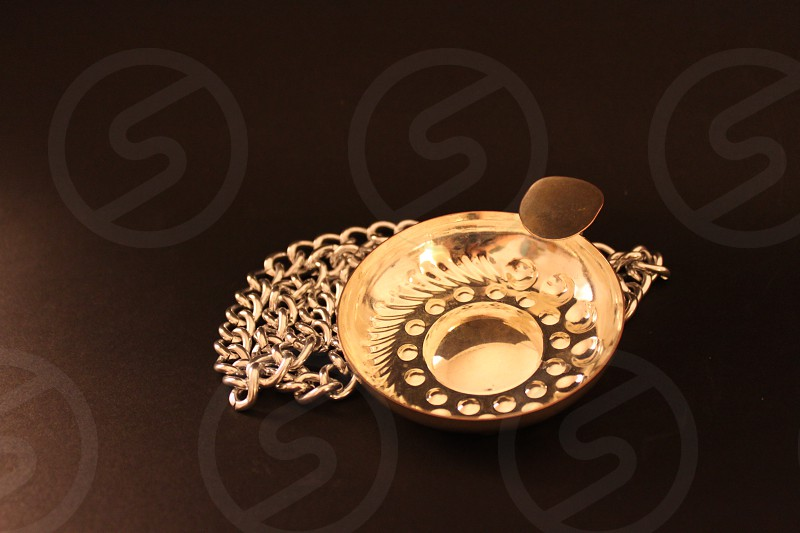 gold round pendant photo