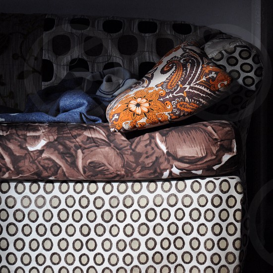 Old sofa with creative textiles photo