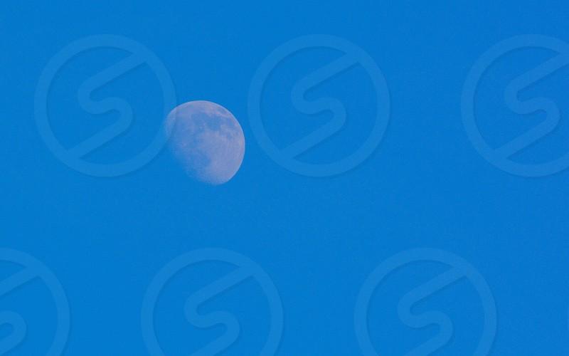 moon with blue sky photo