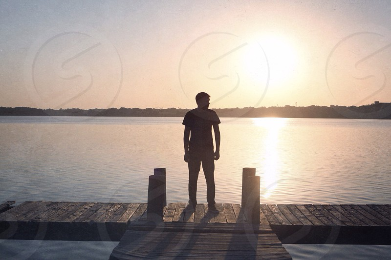 man standing on dock photo