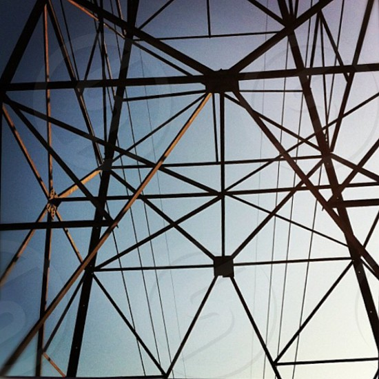 low angle photography of metal tower under gray sky photo