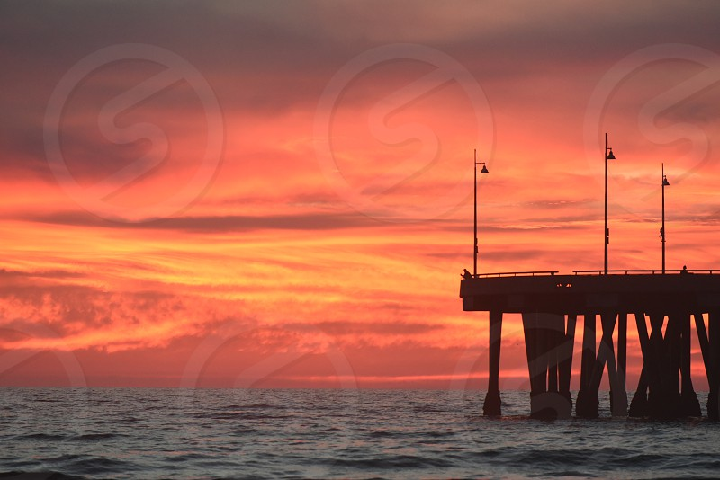 Sunset behind Venice Beach pier photo