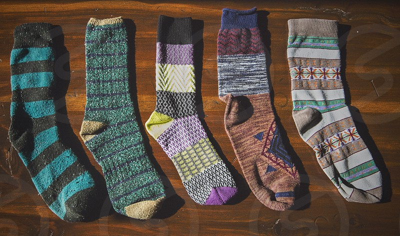 Socks on a wooden table.  photo