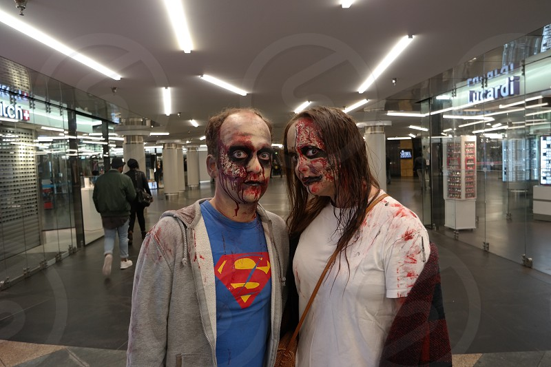 photo of 2 persons in zombie costumes inside establishment photo