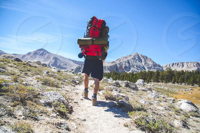 hiking outdoors exercise fit fitness climb hike mountains california adult male backpacking photo