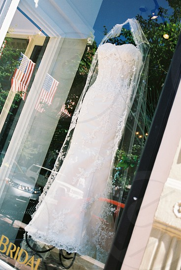 wedding gown in bridal shop window with reflections photo