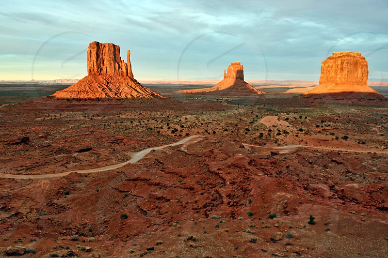 Road through Monument Valley at sunset. photo