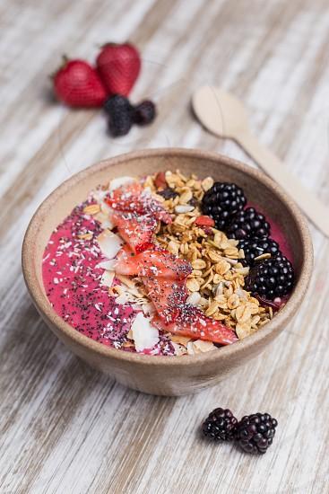 Healthy blackberry dessert with oat and yogurt photo