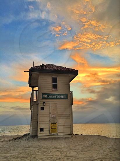 white wooden house near beach photo