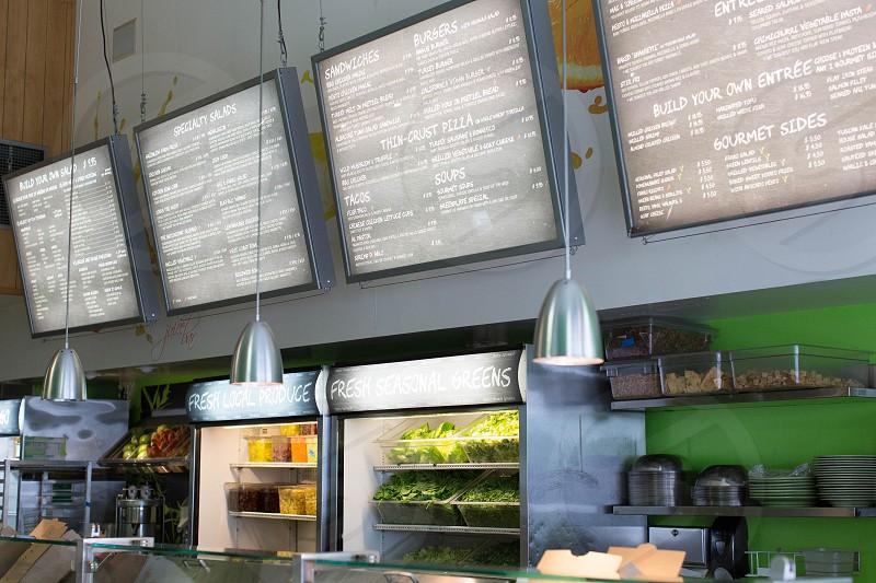 menu board on top of beverages cooler photo
