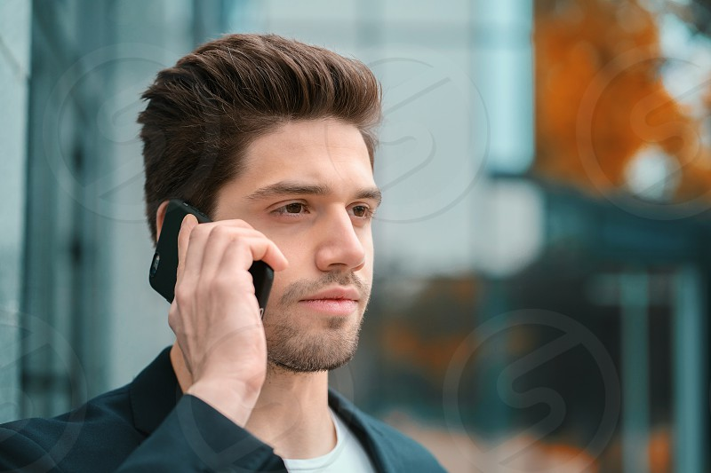 Businessman screaming on mobile phone. Having nervous breakdown at work screaming in anger stress management mental distress problems losing temper reaction on failure. photo