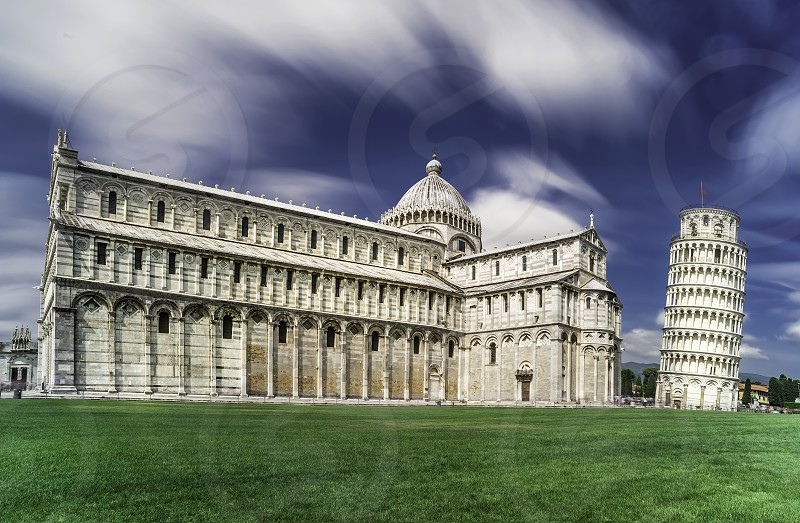 Leaning Tower of Pisa. Blue cloudy sky background photo
