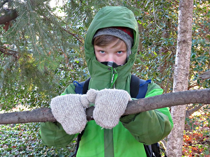 Boy cold weather coat green mittens photo