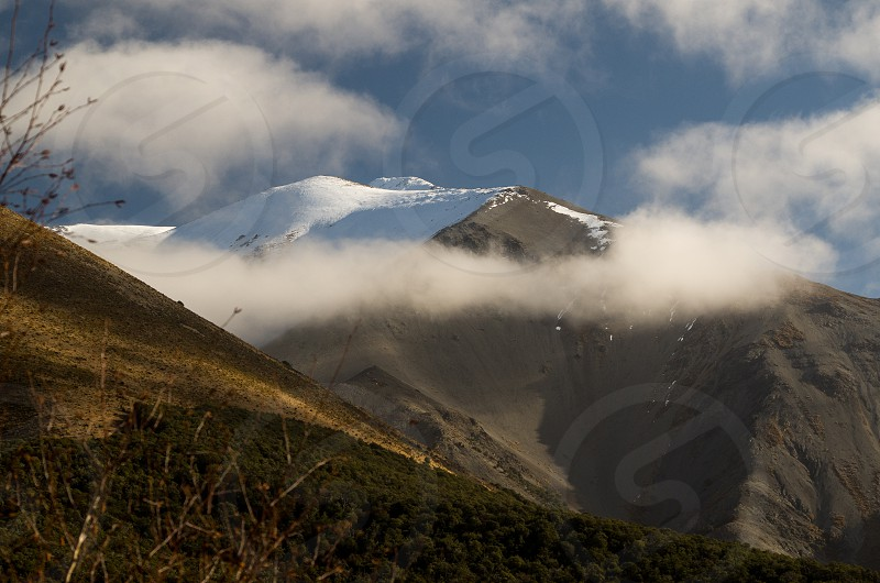 Clouds over the Southern Alps South Island New Zealand. photo