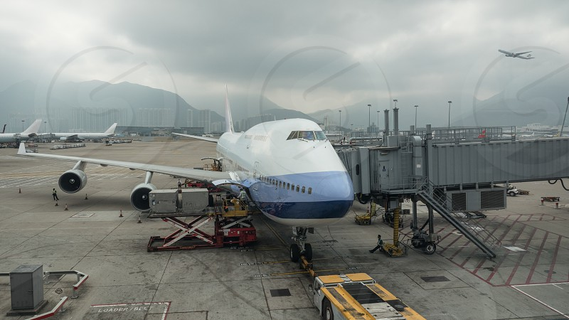 Loading cargo containers into the airplane with airbridge in Hong Kong airport photo