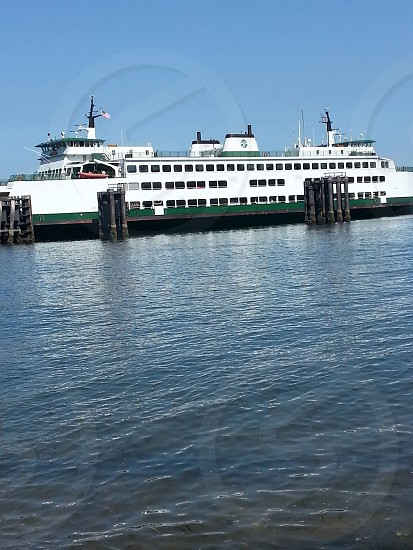 Ferry viewed from the shore of Whidbey Island WA photo