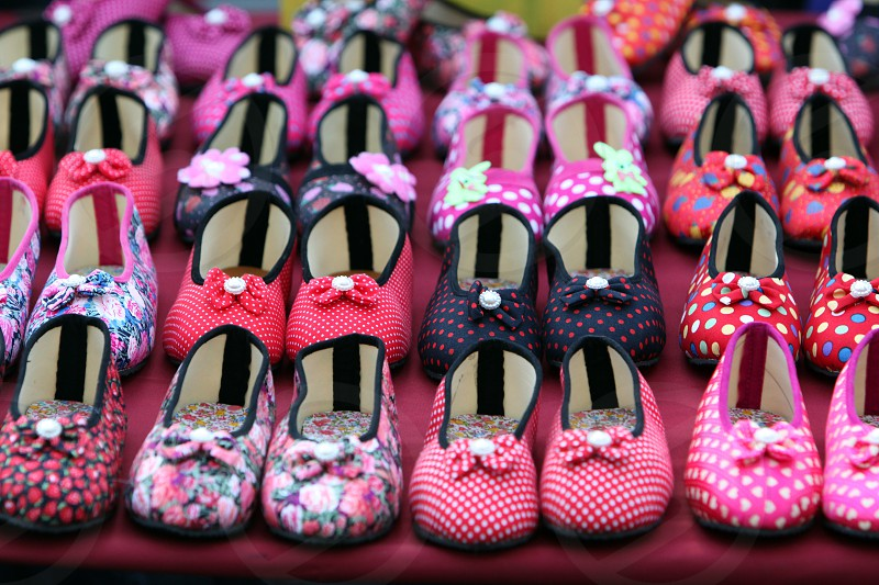 shoes on a market in the city of Amnat Charoen in the Region of Isan in Northeast Thailand in Thailand.