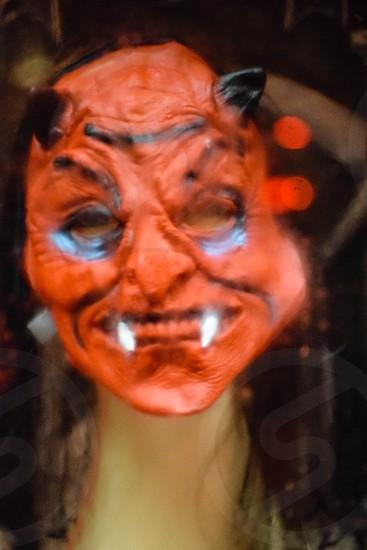orange demon face mask photo