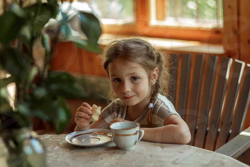 Little girl at breakfast  photo