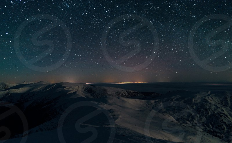 Amazing Panoramic Landscape view of a Milky Way at night sky photo