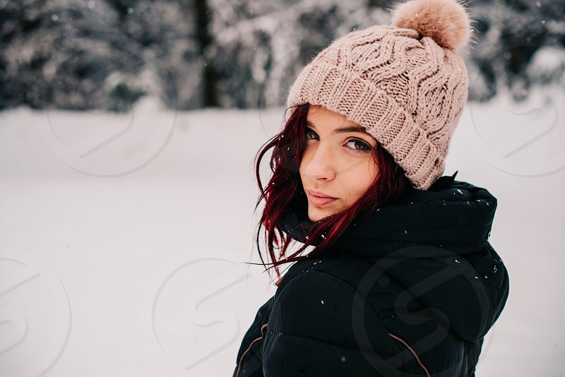 Woman portrait with snowy background. photo