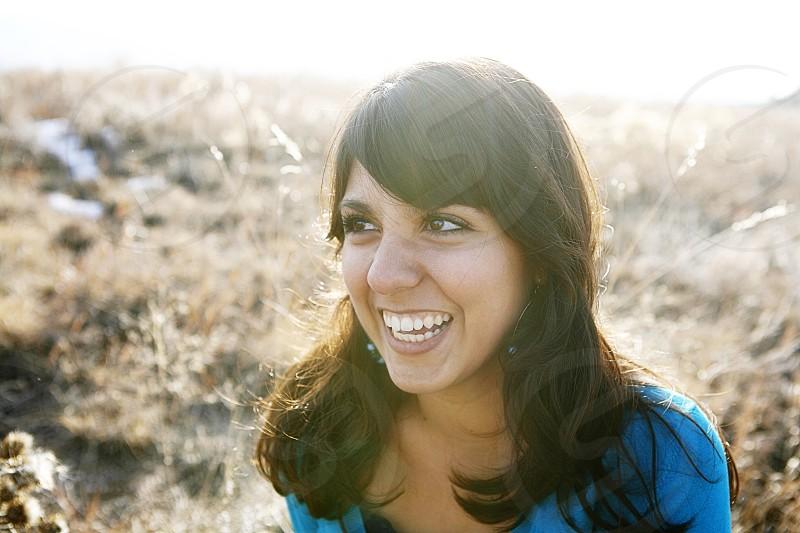 woman wearing blue shirt smiling photo