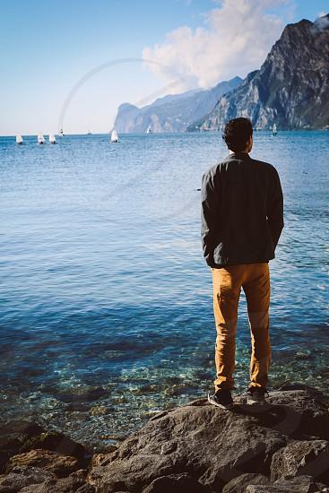 Torbole lake Lake Garda sailboats water rocks mountains blue photo
