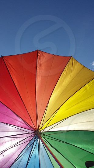 low angle of orange red yellow white pink blue and green parasol photo