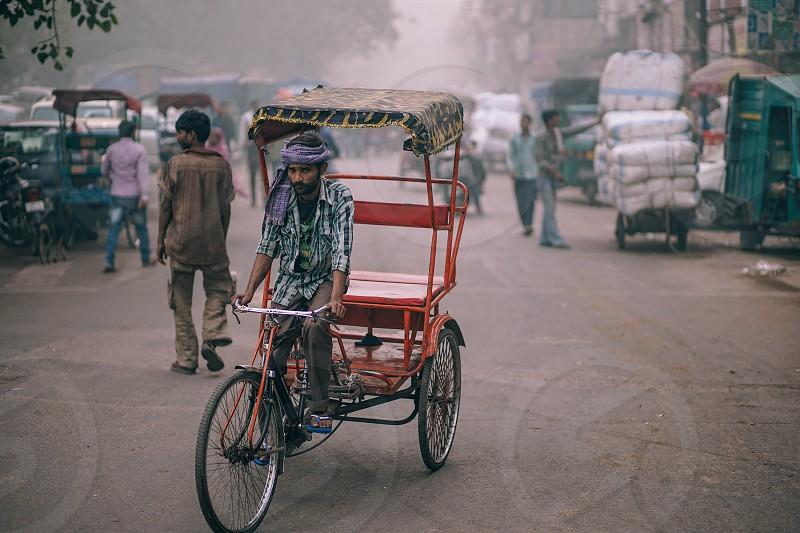 Rickshaw driver looking right at you. photo