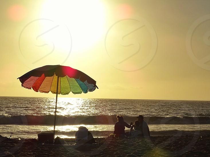 people on seashore during daytime photo