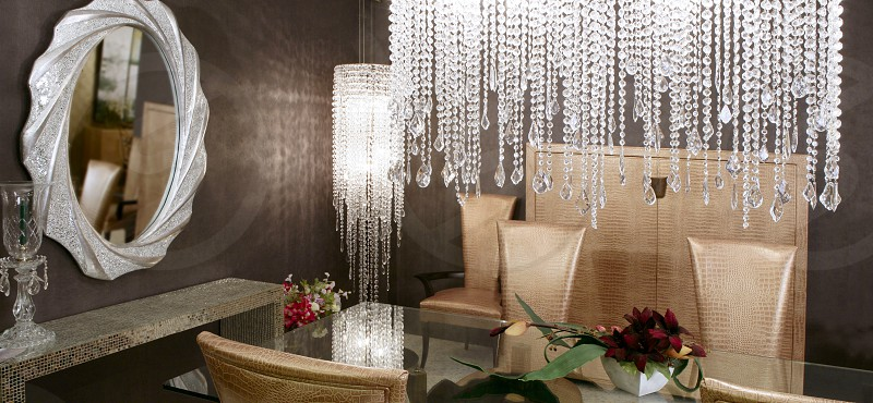 dining room modern crystal strass lamp and crocodile golden chairs photo