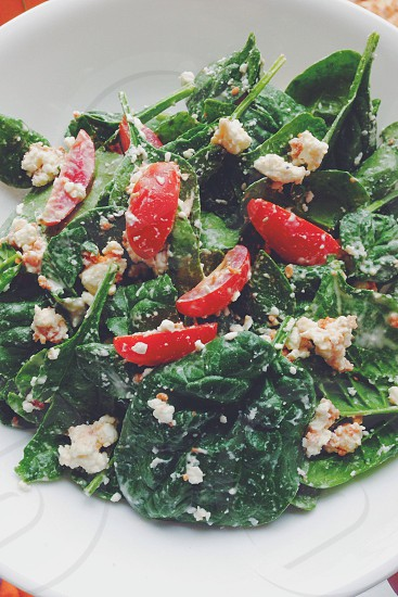 Salad with spinach tomatoes and feta photo