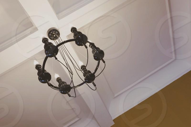 black uplight chandelier turned off photo