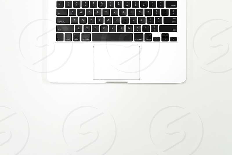 Flat lay photo of white office desk with laptop keyboard top view photo
