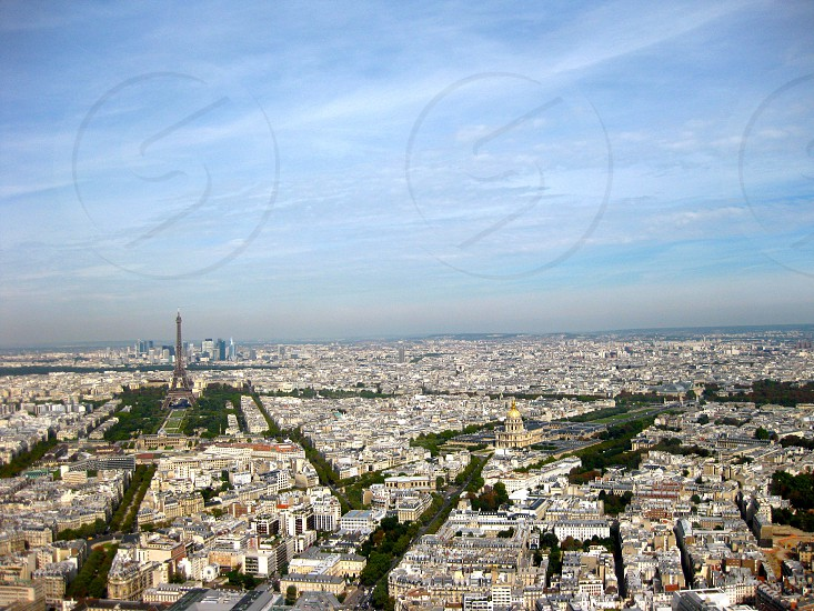 View overlooking Paris the Eiffel Tower and La Defense from Tour Montparnasse. Sunny day. photo