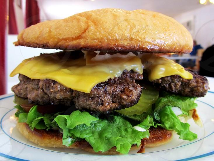 Cheeseburger on toasted bun photo
