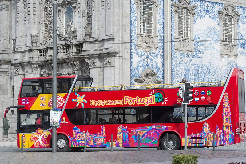 a tourist bus in Ribeira in Ribeira in the city centre of Porto in Porugal in Europe. photo
