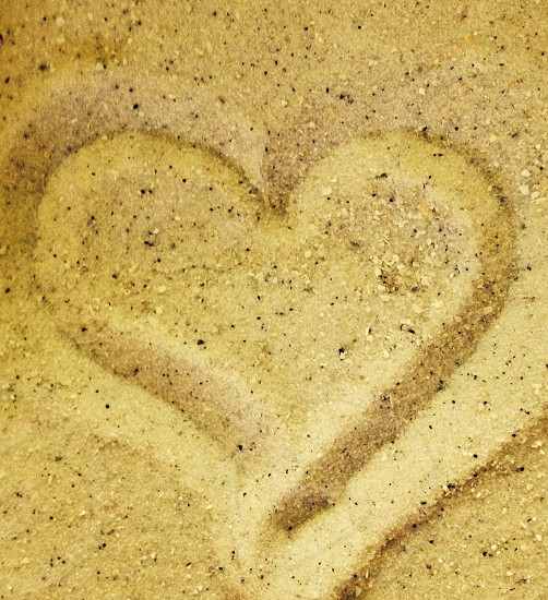 brown sand with heart art photo