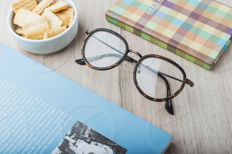 Woman glasses with planner cookies and books photo