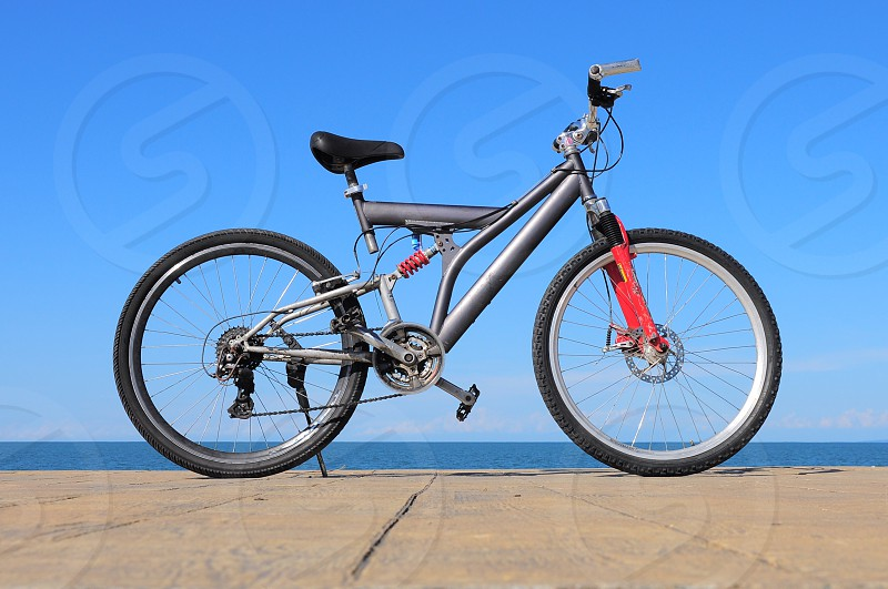 black mountain bike on sand photo