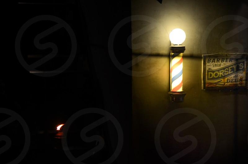 Barbershop in DEUS EX MACHINA at night. photo