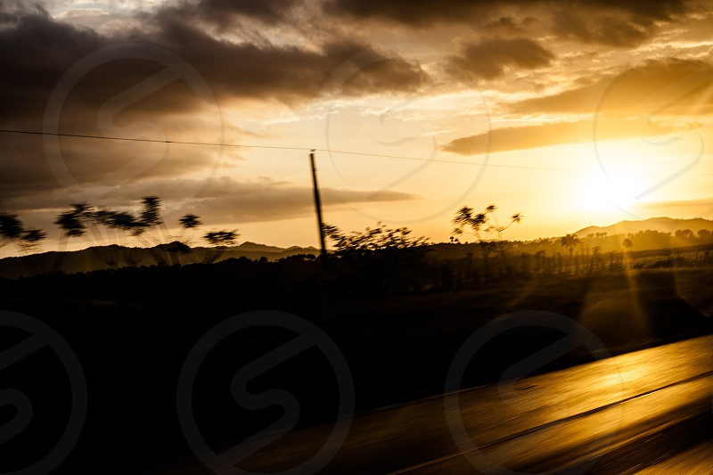 sunset on the road in dominican republic photo