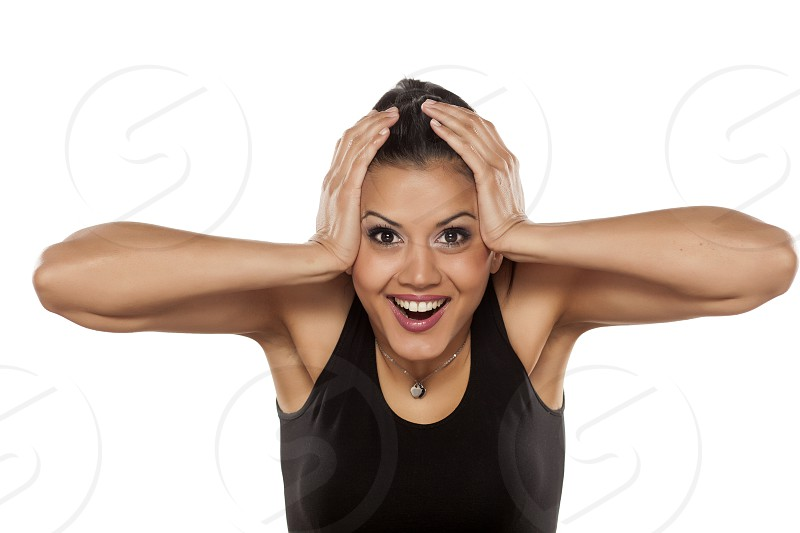 Very happy dark skinned beautiful young woman photo